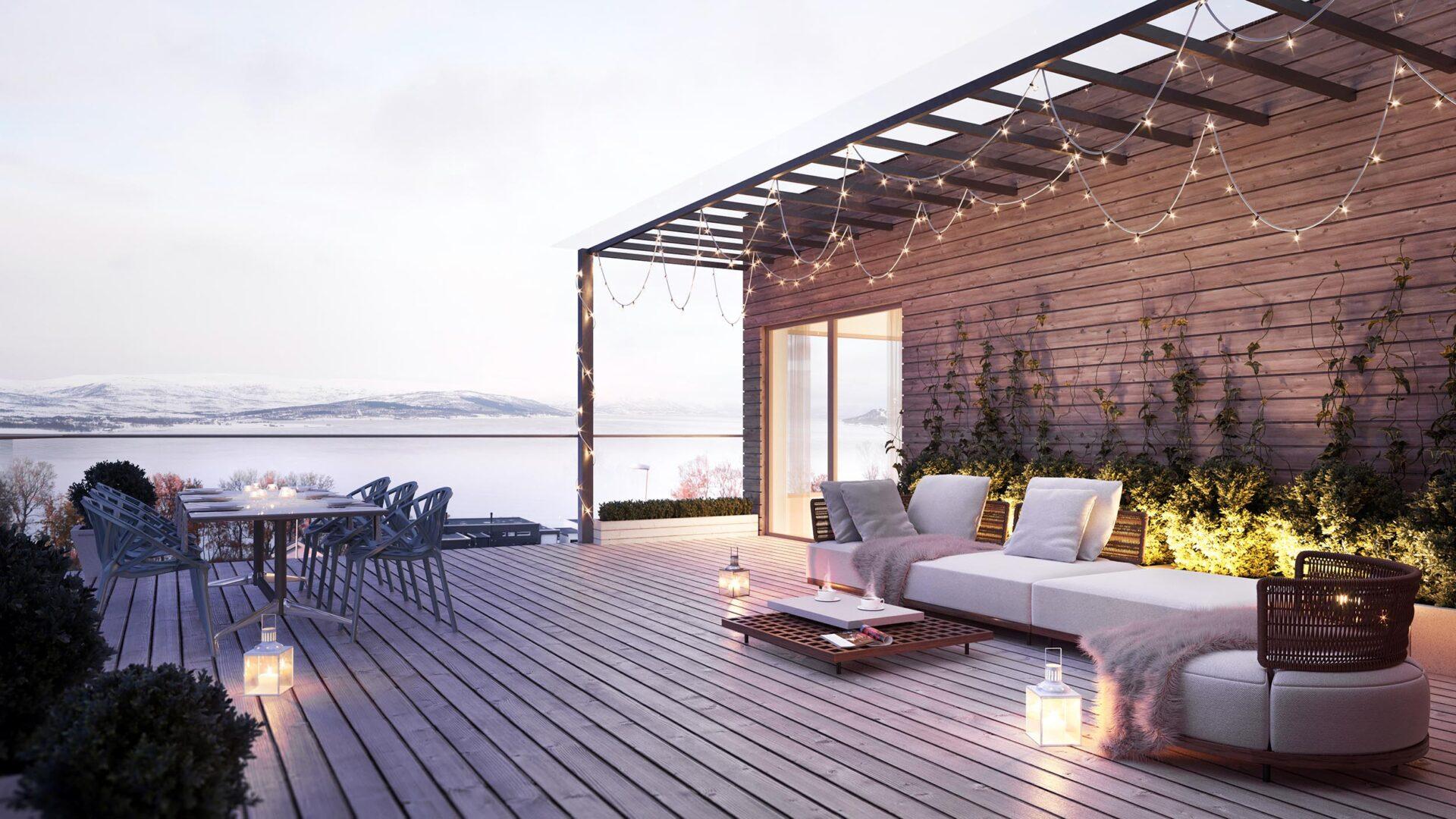 Takterasse med sofa og koselige lys